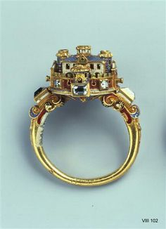 The castle ring that Tywin gifts Sansa that is a pair with the flower ring (Chapter Nine)