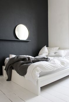 A beautiful fresh white bedroom with black wall!