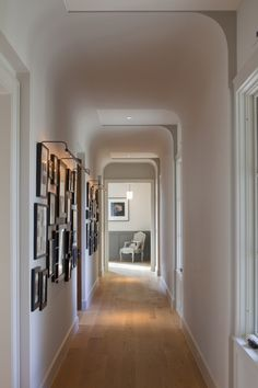 simplicity.  beautiful subtle ceiling detail! love the gallery wall and the gray wainscot in the room at the end of the hall.