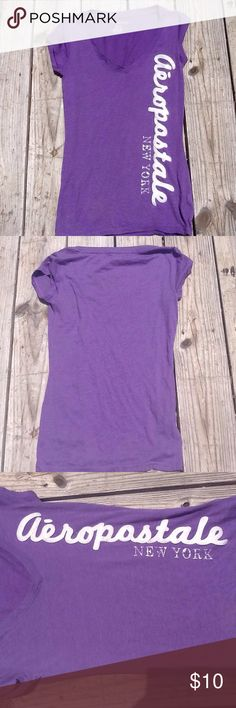 Aeropostale V-Neck Graphic Tee Aeropostale Purple V-Neck. Aeropostale written on the side.Size:M Pre-Loved Condition. ❌Trades ❌Holds ✅Reasonable Offers.Reasonable Offers Accepted. Aeropostale Tops
