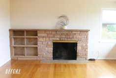 Fireplace BEFORE - $15 and literally a few minutes later this fireplace looks amazing! I can hardly believe it's the same fireplace. Check out the after!