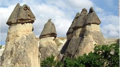 Early settlers made homes in these natural formations called fairy chimneys.  Cappadocia, Turkey