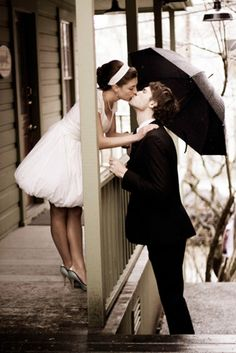 We are so loving this photograph! Umbrellas make a fabulous photo prop.