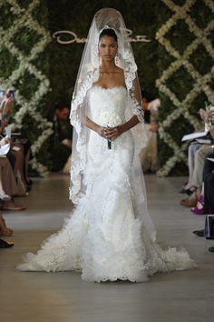 Oscar de la Renta Bridal Spring 2013: White corded Chantilly lace and silk organza ruffle sweetheart gown