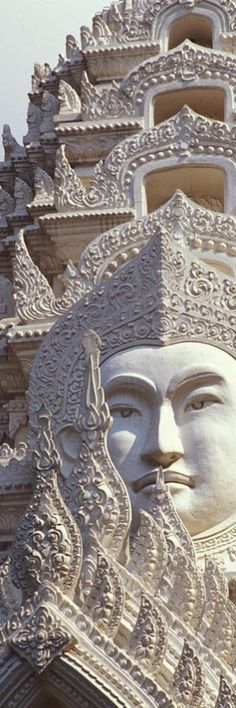 Thailand, Bangkok, Wat Ratchapradt, Buddha Image on ornate stone temple. Credit: Bill Brennan