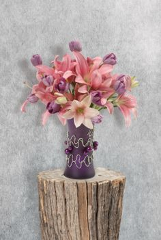 Give mom some spring with tulips & lilies! Decorate a Purple Matte Gathering Vase with OASIS™  Diamond Wire & Beaded Wire http://sona.oasisfloral.com/products/glass-vases/essentials_glassware_from_oasis_floral_products/e940_gathering_vase/colored-gathering-vase/colored-gathering-vase