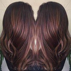 dark brown hair with subtle highlights