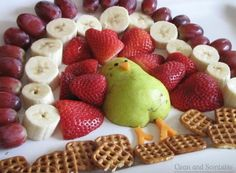 Cute healthy snack for thanksgiving. (Includes: pear, strawberries, bananas, grapes, and Chex!)