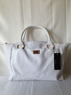 White Purse.   Available at www.rmfashions.net
