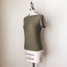 """KATE SPADE   Olive Green Short Sleeve Tee FEATURES:  *High, square neck  *Short sleeves  *100% cotton  MEASUREMENTS: Bust - 30"""" Waist - 29"""" Length - 21 3/4""""  ✅ Good condition ⛔️ NO SWAPS/TRADES/RESERVES kate spade Tops"""