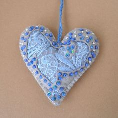 Heart ornament with blue trim