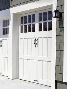 """love old carriage house style garage doors! i also like the darker gray siding with the crisp white trim. """"Sectional doors can feature windows in an upper panel, and some higher-end versions can mimic the look of traditional carriage-house doors."""""""