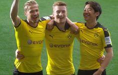 Oliver Kirch, Marco Reus und Shinji Kagawa (v.l.) im neuen BVB-Trikot.