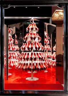 decorating the holiday windows of christian louboutin boutique shops