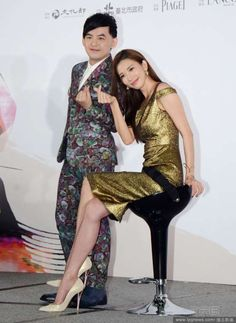 Actor Mickey Huang and actress Lin Chi-ling, who will host the 52nd Golden Horse Awards ceremony, pose for pictures during a press conference of the event in Taipei, Taiwan, Oct. 12, 2015.   http://www.chinaentertainmentnews.com/2015/10/lin-chi-ling-mickey-huang-to-host-52nd_13.html