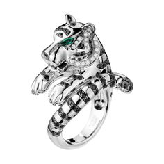 Ring set with pavé diamonds and two cabochon emeralds, in white gold - via Boucheron