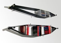 ElasticShelf! Designed by SystemDesignStudio, this simple system is made by stretching recycled bike tire tubes between a couple of used furniture legs to create a functional and handy shelving system.