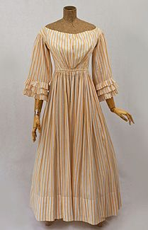 Cotton summer dress, 1830s. The refreshing simple stripe pattern is a rare alternative to standard floral prints. The slightly high waisted bodice is transitional from the 1820s Empire style to the 1850s natural waist position.