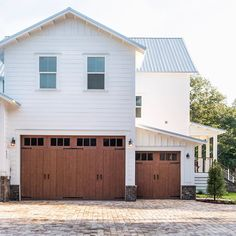 Not many of you have seen this angle of our home yet, so I'm so honored to introduce you to our @clopaydoors Canyon Ridge garage doors!… Farmhouse Interior, Farmhouse Design, Modern Farmhouse, Farmhouse Style, Farmhouse Plans, Modern Country, Country Living, Faux Wood Garage Door, Victorian Style Homes