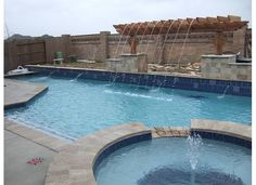 Cantilevered pergola w/water feature for pool