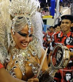 Brazilian star cinema Viviane Araujo of Academico do Salgueiro samba school performs during the first night of Carnival parade at the Sambadrome in Rio de Janeiro on February 10, 2013.