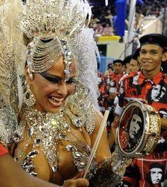Brazilian star cinema Viviane Araujo of Academico do Salgueiro samba school performs during the first night of Carnival parade at the Sambadrome in Rio de Janeiro on February 10, 2013.