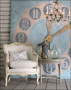 Huge blue and cream painting of a wall clock.  I couldn't find it on the original web site (a sales site).  I think they were highlighting the chair:)  I love the oversized art.