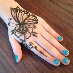 Back hand butterfly mehndi pattern with flower starting on index finger