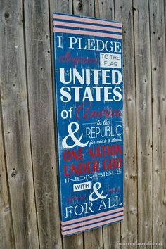 """A cute """"pledge of allegiance"""" sign is an eye-catching way to add a splash of color to your backyard fence."""
