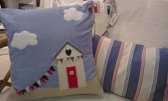 Beach hut cushion set, one with appliqued hut & felt bunting. Crafts by GillyBee