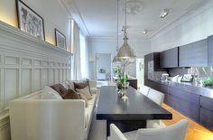 architectural details + sofa dining + industrial pendant + dark cabinets in eat-in kitchen design via sothebys international skeppsholmen se