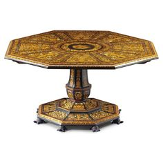 An Italian mother-of pearl inlaid marquetry octagonal centre table by the Falcini brothers with the arms of the Troubetzkoy family circa 1840
