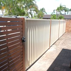 merbau slat gate on colorbond fence - Google Search