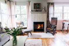 In Puji's Portland house, the fireplace acts as the focal point of the home.