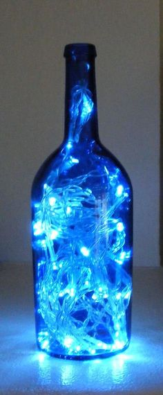 LED Lamp Out of a Wine Bottle Blue: bottle. iv made 1 of these with coloured lights and hand painted the outside of a wine bottle it looks lovely Everything Is Blue, Cool Lamps, Wine Bottle Crafts, Wine Bottles, Perfume Bottles, Blue Bottle, Blue Glass Bottles, Painted Bottles, Wine Glass