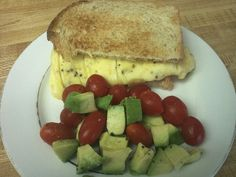 265 total calories 1 egg, 1 whole wheat bread slice, 1/2 string cheese stick, 1/4 small avocado cubed, 12 grape tomatoes, salt and pepper