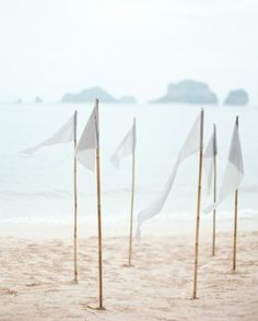 Hand-dyed silk flags marked the ceremony site on Phranang Beach.                                                                                                                                                      More
