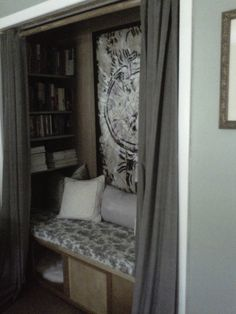 My sister uses a guest room as a dressing room. She changed her closet into a 'reading nook.' A handyman made the storage chest and the shelves. She sewed the cushion and used burlap for a backdrop to add texture. This is my favorite space in her home. So cozy. I would curl up in here everyday.