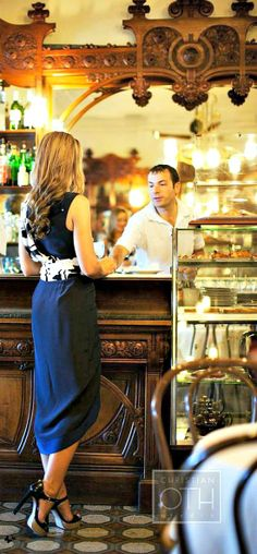 Traveling - gorgeous bar in Lake Como, Italy I should look into high low midi skirts, she looks so good in this outfit