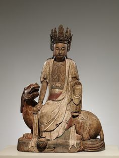 Bodhisattva Kwan Yin (Avalokiteshvara), 19th–20th century, single-woodblock carving of willow wood with traces of pigment, China.