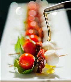 Great ideas for appetizers, presentations - here, cherry tomato, basil, sundried tomato, mozzerella