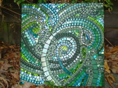 if not using rays to edges of the kitchen (just around the cross), what kind of pattern in the rest of the mosaic? you like these kinds of swirls? use blues instead to go with your kitchen.