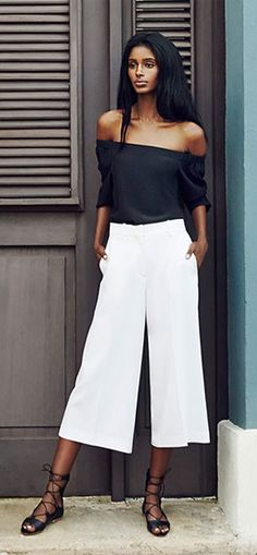 black off the shoulder top and white wide-leg culottes