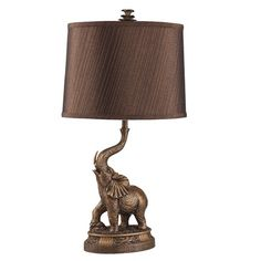 Featuring a striking, sophisticated elephant base, this bronze lamp is the perfect addition to lend style to your home. This resin lamp is finished with a metallic bronze linen shade. Elephant Lamp, Elephant Table, Elephant Home Decor, Elephant Stuff, Safari Home Decor, 60 Watt Light Bulb, Light Bulb Types, Animal Print Furniture, Bauhaus
