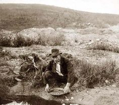 An extraordinary photo of Miner panning gold. It was made in 1916. The photo documents Gold mining.