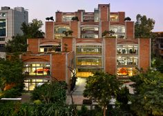 Indian office block by SPA Design features brick arches and stepped rooftop gardens.