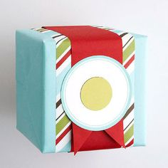 Small gifts will look artfully crafted when you layer leftover pieces of wrapping paper and ribbon in interesting ways. Mix and match contrasting colors and feel good about using the most of what you have.                 Copyright &copy 2012 Meredith Corporation.