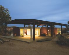 Two multi-slide doors open this desert home to let in the breeze after sunset. Desert shed, dwell, desert landscaping, modern, contemporary, California, http://www.westernwindowsystems.com