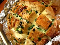 Party Bread - cut sourdough loaf into checkerboard, stuff with monteray jack cheese, mix 1/2 c melted butter, 2 to 3 teaspoons of poppyseeds and 1/2 cup chopped green onions and drizzle over top.  Wrap in foil, Bake at 350 for 15 minutes.