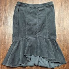 Pilcro and the Letterpress Corduroy Trumpet Skirt Pilcro's cord fit-and-flare skirt from Anthropologie. New with tags $78 retail. Has a flowing hemline into a contouring pencil frame. Size zip with hook closure. 98% cotton 2% spandex. 21 inches long. Gray corduroy. Size 2(xs) drop waist 28 in, natural waist 26, hips 36. Anthropologie Skirts